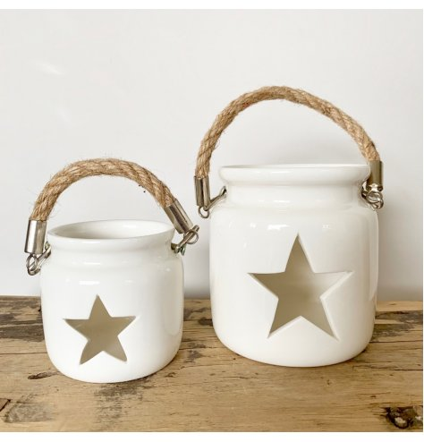 A shabby chic inspired lantern with a star shaped cut out design. Complete with a chunky rope handle and silver details.