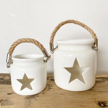 A chic white lantern with a star cut out feature and chunky rope carry handle.