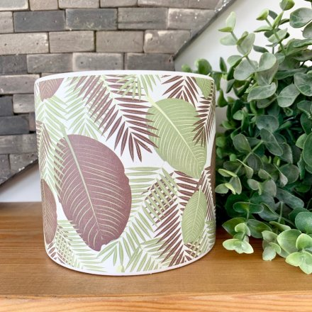 A large ceramic planter with a colourful leaf print design including a fern pattern.