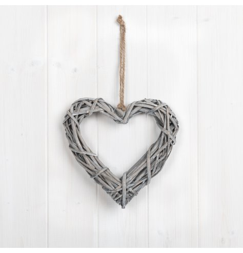 A small natural rattan hanging heart, perfect for adding additional foliage. With jute for hanging.