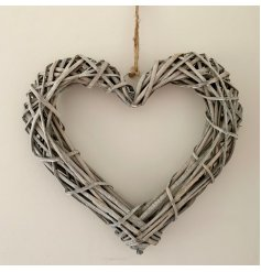 A rustic rattan heart wreath with a chunky rope hanger.
