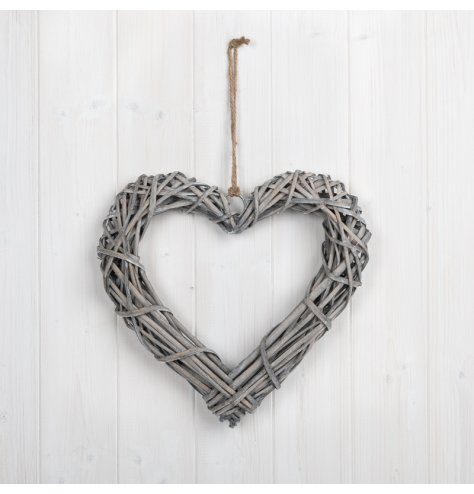 A medium natural rattan hanging heart, perfect for adding additional foliage. With jute for hanging.