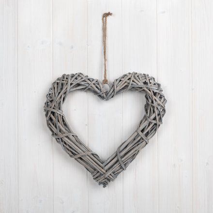 A classic woven rattan heart with a rustic finish and chunky rope hanger.