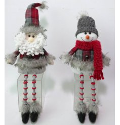 A festive mix of fabric sitting Santa and Snowman Characters, complete with long dangly legs!