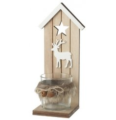 A large wooden candle holder complete with faux fur trimmings and a cut stag decal