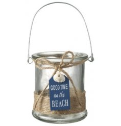 A small glass candle pot complete with a jute string decal and hanging blue tag with a coastal text