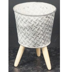 Embossed Zinc Pot, 17cm   Stood on natural wooden legs, this beautifully rustic zinc pot also features a geometric inspi