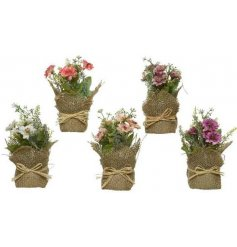 this mix of floral bunches wrapped in hessian will be sure to add a splash of colour to any space