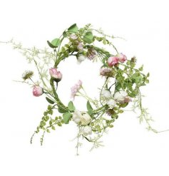 A delicate artificial rose wreath with pretty pink petals and entwining vines