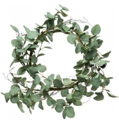 A large round wreath made up of artificial Eucalyptus leaves