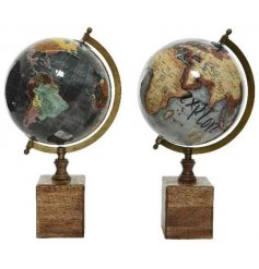 A mix of 2 antique inspired decorative globes on chunky wooden bases.