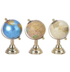 A mix of 3 luxury coloured globe ornaments, each with gold stands.