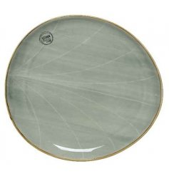 A smooth glazed porcelain plate featuring a distressed edging and charming Sage Green tone