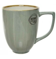 A smooth glazed porcelain mug featuring a distressed edging and charming Sage Green tone