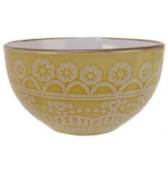 Covered with a cheerful yellow tone, this large bowl also displays a beautiful floral mandala decal and smooth glaze fi