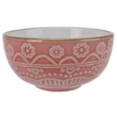 Covered with a pretty pink tone, this quirky bowl also displays a beautiful floral mandala decal and smooth glaze finis