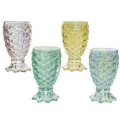A mix of four funky themed drinking glasses in an assortment of iridescent colours