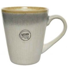 A simple and stylish stoneware mug with a decorative subtle stripe pattern. An easy living kitchen item.