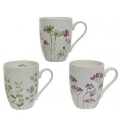 An assortment of 3 porcelain mugs, each with a delicate floral watercolour print.