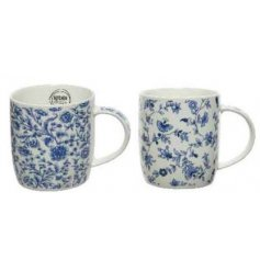 An assortment of 2 porcelain mugs, each with a classic ditsy floral design.