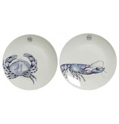 An assortment of 2 breakfast plates each with a graphic crab and lobster design.