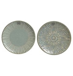 An assortment of 2 porcelain dinner plates with a decorative floral and burst pattern.