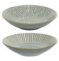 An assortment of porcelain bowls decorated with distressed stoneware inspired colours and etched decals