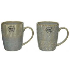 An assortment of porcelain mug decorated with distressed stoneware inspired colours and etched decals