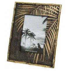 An elegant, tropical inspired, luxury photo frame with gold bamboo detailing and a graphic palm leaf.