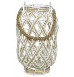 A chic white and natural lantern with a woven pattern and chunky rope handle.