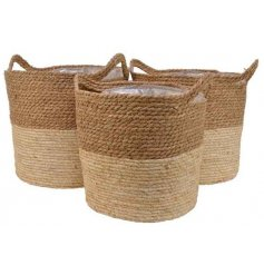 A set of 3 natural woven planters with a rustic colour block finish. Complete with handles and lining.