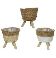 A mix of 3 woven planters in colour block designs. Each has a rustic finish and comes fully lined.