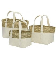 Stay organised and stylish with these functional fabric baskets. Each is made from felt with woven rattan details.