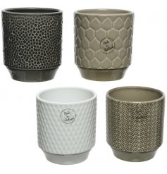 An assortment of 4 stoneware planter pots, each decorated with its own colouring and textured details