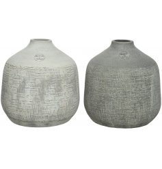 these round terracotta vases also feature a distressed scratch mark detail