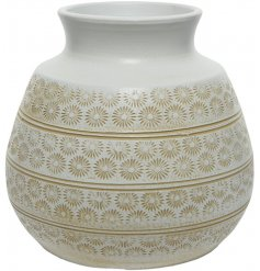 A beautiful round terracotta vase featuring an embossed floral decal