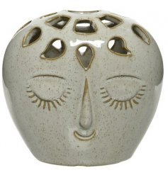 An on trend themed vase set with a smooth speckle glaze finish and happy face embossment