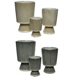 A mix of chic stoneware planters with a stripe design in natural cream and grey colour assortments.