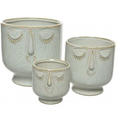 A mix of 3 enchanting stoneware planters in assorted sizes. Each features a unique dreaming face.
