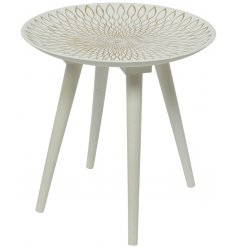 A chic white washed side table with a beautiful golden sun design. A stylish interior accessory to compliment many theme