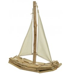 A nautical driftwood boat decoration with fabric sails and shells.