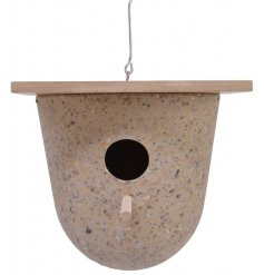 A contemporary sand coloured bird house made from 80% coffee husk. Complete with a bamboo roof and wooden perch.
