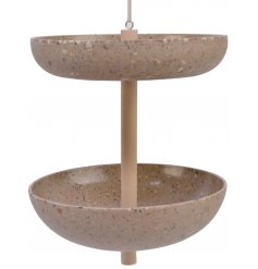 A chic sand coloured bird feeder with two bowls for seeds. An elegant garden accessory made from 80% coffee husk.