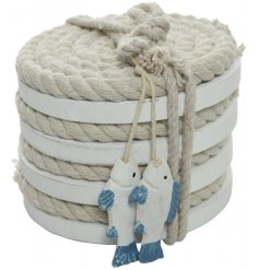 A set of 4 chunky rope coasters with a white washed finish. Each is bound together with rope