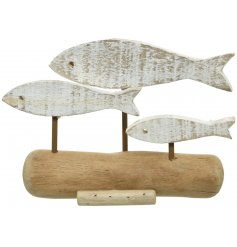 Made up of distressed driftwood, this decorative swimming fish ornament will be sure to add a coastal charm to any int