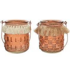 An assortment of Sunkissed Orange Candle Holders, each complete with a tassel trimming and ridged decal