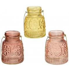A mix of small coloured bottles each featuring a stylish ridged decal and wire handle