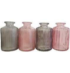 Bring a hint of blush to your decor with this charming mix of ridged Vases