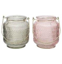 Bring a hint of blush to your decor with this charming mix of ridged candle lanterns