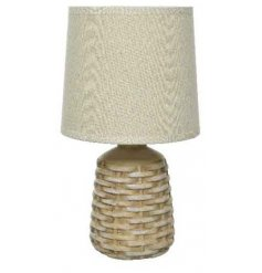 A beautiful natural toned table lamp, complete with a woven inspired ceramic base